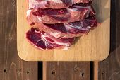 Overhead View Of Raw Cuting Pieces Of Pork On Wooden Background. Piece Of Fresh Boneless Pork, Neck  poster