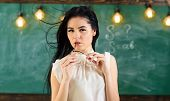 Teacher With Glasses And Waving Hair Looks Sexy. Woman With Long Hair In White Blouse Stands In Clas poster