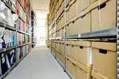 Stacks Of Files And Paperwork Placed In Bookshelves With Folders And Documents In Cardboard Box Arch poster