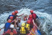 Rafting In Life Jackets, Men On A Catamaran. Extreme Sports In A Mountain River. poster