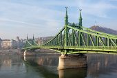 The Liberty Bridge In Budapest In Hungary, It Connects Buda And Pest Cities Across The Danube River. poster
