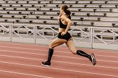 Female Athlete Runner Run Stadium On Background Stadium Seating poster