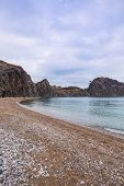 Sea Coast Of Turkey. Calm Sea And Cliffs. Secluded Place. Ocean Coast On A Cloudy Day. Rocky Beach. poster