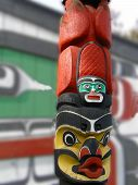 foto of indian totem pole  - Detail Totem pole carved from cedar Thunderbird Park Victoria BC Canada - JPG