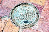 pic of boise  - Water cover plate on brick path in Boise Idaho - JPG