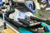 Screw For Adjusting Forward Pressure In A Ski Binding Using A Screwdriver, After Clipping The Ski Bo poster
