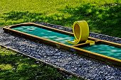 stock photo of miniature golf  - Small golf course built for children in a recreational space - JPG