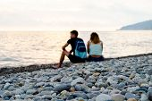 Young White Guy And Girl On The Beach. Back To The Camera. Focus In The Foreground. Dramatic Sky At  poster