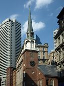 Historic Brick Church And Modern Buildings poster