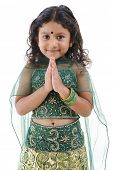 foto of traditional dress  - Cute little Indian girl in a greeting pose - JPG