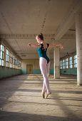 Ballerina Dancing In An Old Building. Young, Elegant, Graceful Woman Ballet Dancer. Toe Walking, Tec poster