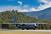picture of c130  - C130 gunship taking off from Samui Airport - JPG