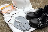 stock photo of personal safety  - a collection of personal protection equipment issued to workers as regulated by the industry - JPG