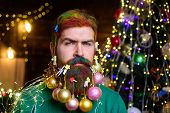 Christmas Beard Decorations. Serious Santa Man With Decorated Beard. New Year Party. Bearded Santa M poster