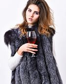 Woman Drink Wine Wear Luxury Fur Clothing. Luxury Lifestyle Concept. Fashionable Lady Likes Luxury.  poster