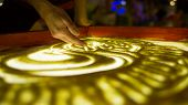 Drawings In The Sand. Art Therapy. Sand Animation. Female Fingers Draw A Heart In The Sand. The Deve poster
