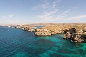 Stone cliffs on the blue lagoon of the island of Comino and Gozo Malta. Mediterranean Sea poster