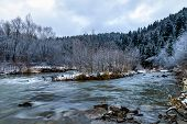 December Nature Scenery Landscape - Picturesque River Among Mountains And Frosted Trees At Daybreak  poster