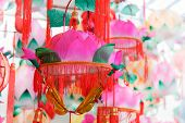 Group of Traditional colorful Chinese Lotus shaped Lanterns hanging for Chinese new year and Chinese poster