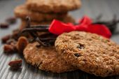 stock photo of baked raisin cookies  - Pile of wholegrain cookies with raisins and nuts - JPG