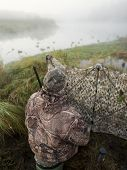 foto of duck-hunting  - A man duck hunting on a foggy morning - JPG