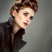 picture of overcoats  - Portrait of elegant young woman in a grey overcoat  on a grey background - JPG