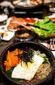 stock photo of bap  - Traditional Korean Bibim Bap with shallow depth of field on background showing Korean cuisine - JPG