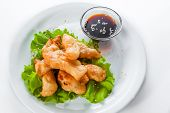 image of collate  - shrimp tempura with lettuce and sesame seeds on a white background - JPG