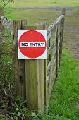 picture of no entry  - No entry sign attached to a gatepost.