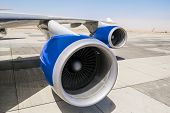 foto of chassis  - Jet engine on the wing of an airplane on the runway - JPG