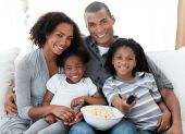 Afro-american Family Watching Television At Home