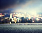 foto of dots  - Asphalt road and blurred modern city - JPG