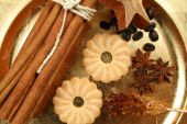 pic of ouzo  - Cinnamon sticks anise stars and sugar cookies on the golden plate - JPG