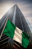 foto of nigeria  - Nigeria national flag against low angle view of skyscraper - JPG