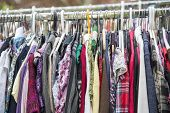foto of thrift store  - clothes on a rack in a flea market  - JPG