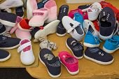 pic of stall  - Loads of children shoes on a street market stall - JPG