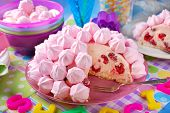 stock photo of cake-ball  - beautiful birthday cake in ball shape decorated with pink meringue cookies whipped cream and raspberries for girl  - JPG