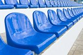 foto of grandstand  - Empty plastic chairs are on grandstand stadium - JPG