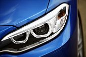 stock photo of headlight  - Detail on one of the LED headlights of a car.