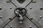 picture of door-handle  - A door handle ralten a heavy metal door  - JPG