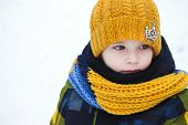 picture of little boys only  - little boy on a walk in the winter yellow cap