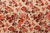 stock photo of knitwear  - new light beige knitwear with red vintage floral pattern - JPG