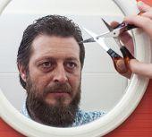 pic of beard  - Bearded man preparing to cut his beard with scissors - JPG