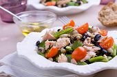 stock photo of black-cherry  - Tuna salad with green black and white beans garnished with fresh cherry tomatoes - JPG