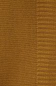 foto of knitting  - close up of a rust colored knitted background pattern, knitted right and left, detail, full frame, vertical ** Note: Visible grain at 100%, best at smaller sizes - JPG