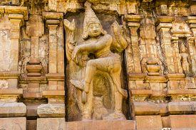 picture of gatekeeper  - Magnificent statue of right side gatekeeper engraved on entrance gopuram of Brahadeewarar temple - JPG