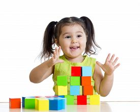 picture of child development  - toddler child girl playing wooden toy blocks isolated - JPG
