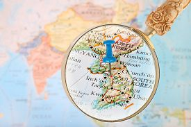 foto of south east asia  - Blue tack on map of Asia with magnifying glass looking in Seoul South Korea - JPG