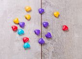stock photo of valentine candy  - Heart shaped valentine candy on wooden background - JPG