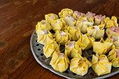 picture of steam  - This a photo of Chinese Steamed Dumplings on wood table - JPG
